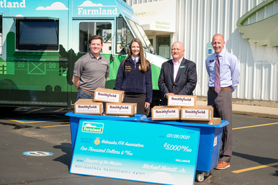 Left to right: Jonathan Toms, Smithfield Foods Charitable Initiatives Manager, Ellie Wanek, Nebraska FFA President, Brian Barks, President and CEO for Food Bank for the Heartland, Craig Todd, Omaha District Store Manager for Hy-Vee.