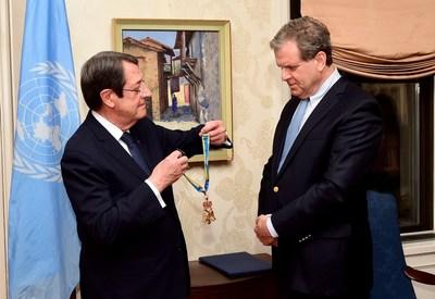 Cyprus President Nicos Anastasiades presents one of his country's most prestigious awards to AJC CEO David Harris. Photo by Dimitrios Panagos