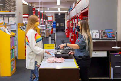 Staples employee scanning Happy Returns QR code to verify the return and initiate the refund.