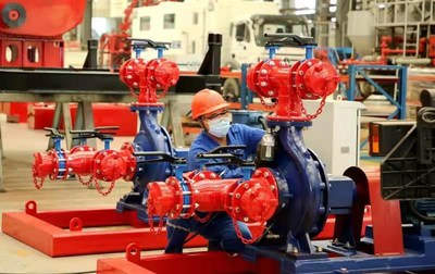 An assembly worker busy catching up with orders in Kerui High-end Petroleum Equipment Industrial Park, Dongying, Shandong
